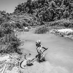 Fea0093883. DT News.The Ankeniheny-Zahamena Corridor, Madagascar.Pic Shows a young woman panning for gold in a mine close to Tananarive