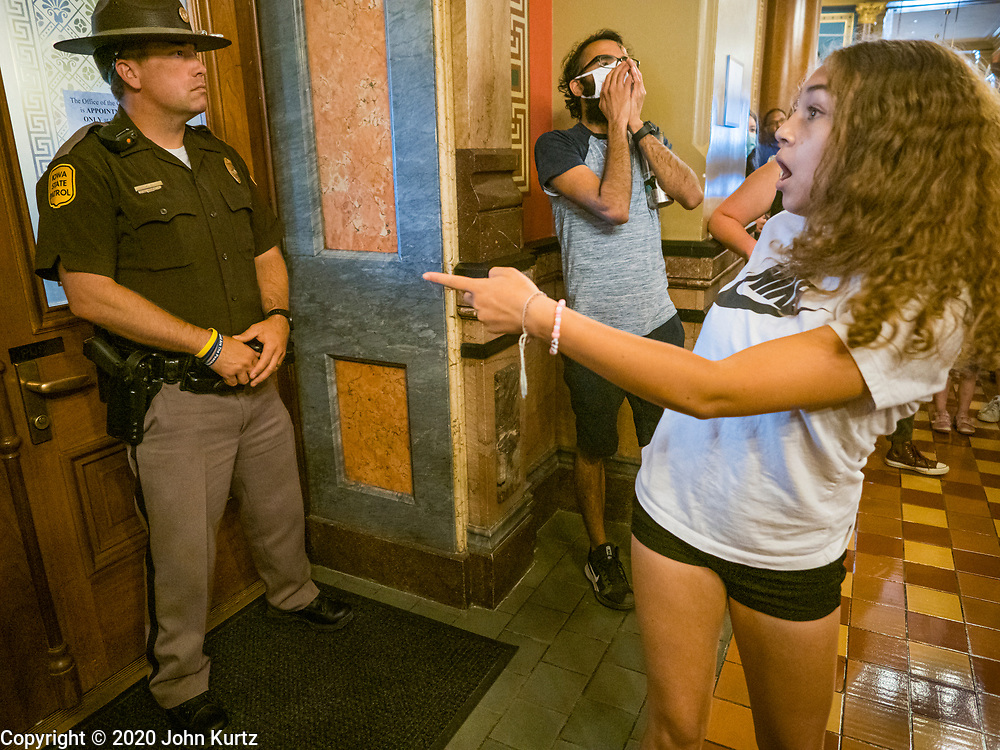15 JUNE 2020 - DES MOINES, IOWA: LYRIC (first name only) shouts at Iowa State Troopers guarding the Governor's Reception Room in the Iowa capitol in Des Moines. About 75 supporters of Black Lives Matter marched through the Iowa capitol Monday to demand the restoration of voting rights for felons who have completed their sentences. Iowa is one of only two states in the US that permanently strip felons of voting rights. The issue is a  racial one in Iowa. Blacks make up only 4 percent of the population but 25 percent of the prison population. The Governor agreed to meet with a delegation of the protesters but she would not commit to immediately restoring voting rights. She said would draft an executive order to restore voting rights later in the summer.     PHOTO BY JACK KURTZ