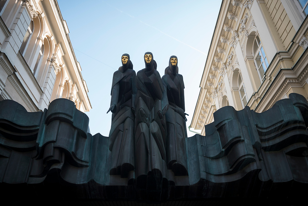 Vilnius, Lithuania - August 6, 2015: The three muses atop the Lithuanian National Drama Theater in Vilnius, Lithuania.
