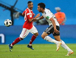 June 19, 2018 - Saint Petersburg, Russia - Alexander Samedov (L) of the Russia national football team and Trezeguet of the Egypt national football team vie for the ball during the 2018 FIFA World Cup match, first stage - Group A between Russia and Egypt at Saint Petersburg Stadium on June 19, 2018 in St. Petersburg, Russia. (Credit Image: © Igor Russak/NurPhoto via ZUMA Press)