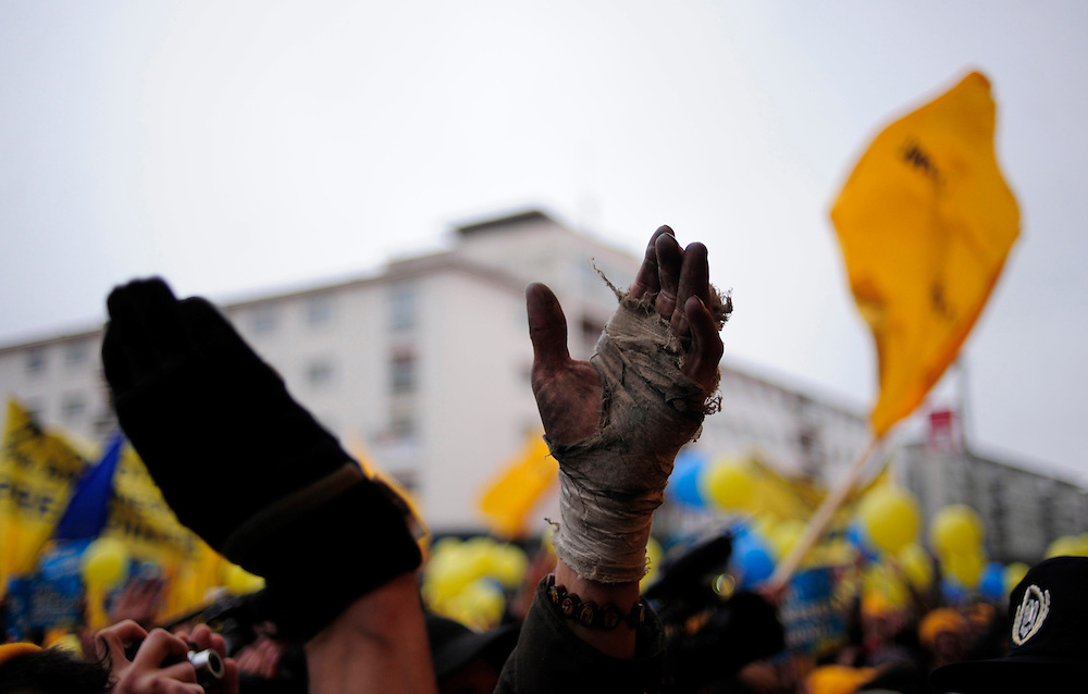 A men claps during a political rally organized by the National Liberal Party, in their run for the presidential race.