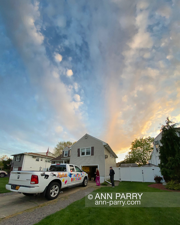 Seaford, New York, U.S.  May 5, 2020. JOE CESTARE decorates Happy Birthday Truck for his friend Ava Cea, a nurse who is a frontline worker at North Shore University Hospital Northwell Health, in Manhasset, during COVID-19 pandemic. Cestare, the owner of Signarama in Bellmore, plans to drive the truck the next day in front of hotel where Cea is staying to avoid exposing her parents to the virus.