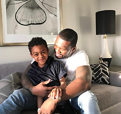 """50 Cent releases a photo on Twitter with the following caption: """"""""This guy is part two, his personality he's already better than me. I just got a few things to teach him. #lecheminduroi #bransoncognac"""""""". Photo Credit: Twitter *** No USA Distribution *** For Editorial Use Only *** Not to be Published in Books or Photo Books ***  Please note: Fees charged by the agency are for the agency's services only, and do not, nor are they intended to, convey to the user any ownership of Copyright or License in the material. The agency does not claim any ownership including but not limited to Copyright or License in the attached material. By publishing this material you expressly agree to indemnify and to hold the agency and its directors, shareholders and employees harmless from any loss, claims, damages, demands, expenses (including legal fees), or any causes of action or allegation against the agency arising out of or connected in any way with publication of the material."""
