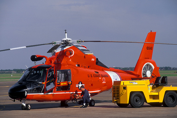 United States Coast Guard Helicopter and Maintenance Person at Ellington Field