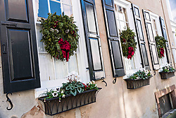 December 21, 2017 - Charleston, South Carolina, United States of America - Christmas wreaths hung from windows on a historic home on Tradd Street in Charleston, SC. (Credit Image: © Richard Ellis via ZUMA Wire)