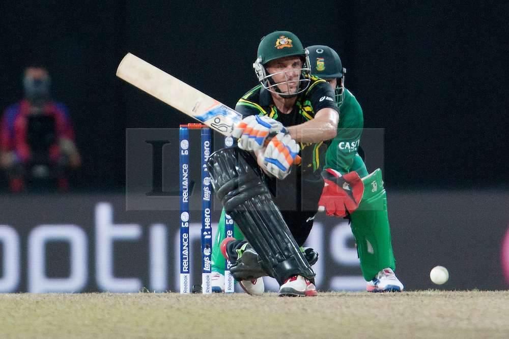 © Licensed to London News Pictures. 30/09/2012. Australian Michael Hussey plays a reverse sweep shot  during the T20 Cricket World super 8's match between Australia Vs South Africa at the R Premadasa International Cricket Stadium, Colombo. Photo credit : Asanka Brendon Ratnayake/LNP