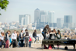 © Licensed to London News Pictures. 10/04/2014. London, UK Visitors look at the skyline in bright sunshine at Greenwich Park in London today, 10 April 2014,The weather forecast is set to be brighter and warmer over the coming days.Photo credit : Stephen Simpson/LNP
