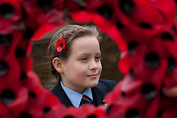 © under licence to London News Pictures 11/11/2010 Solihull School, West Midlands, came to a standstill at 11am this morning to take part in the school Armistice service. Pupil Ellie Berrow (9) falls silent in remembrance. ..