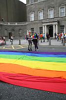 Multi-coloured rainbow flag at the Dublin Pride 2012 LGBTQ festival parade Dublin City. Saturday 30th June 2012.