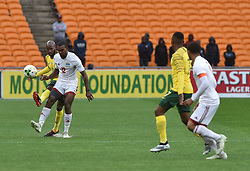 South Africa: Johannesburg: Bafana Bafana player Ramahlwe Mphahlele battle for the ball with Seychelles player Perry Monnaie during the Africa Cup Of Nations qualifiers at FNB stadium, Gauteng.<br />Picture: Itumeleng English/African News Agency (ANA)