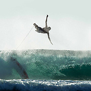 A surfer wipes out at Desert Point, Lombok, Indonesia attracting some of the worlds best surfers to this remote surf spot.