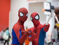 © Licensed to London News Pictures. 24/10/2015. London, UK. A couple of Cosplayers dressed as Spiderman take a selfie at the MCM London Comic Con in London ExCeL on Saturday October 24th. Photo credit : Isabel Infantes/LNP