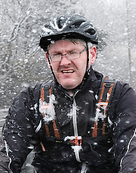Heavy Snowfall in West Lothian, Wednesday, 4th April 2018<br /> <br /> More heavy snow fell in West Lothian this afternoon causing traffic problems for drivers on the M8 Edinburgh to Glasgow motorway.<br /> <br /> A brave cyclist battles through the snow<br /> <br /> Alex Todd   EEm
