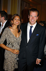 """JOEL CADBURY and DIVIA LALVANI at a party to celebrate the publication of Bruce Oldfield's autobiography """"Rootless"""" held in aid of Crimestoppers at Claridge's, Brook Street, London W1 on 22nd September 2004.<br /><br />NON EXCLUSIVE - WORLD RIGHTS"""