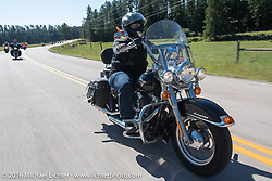 Connie Price on the Harley-Davidson Angels Ride to benefit the Nature Conservancy during the annual Sturgis Black Hills Motorcycle Rally.  SD, USA.  August 12, 2016.  Photography ©2016 Michael Lichter.