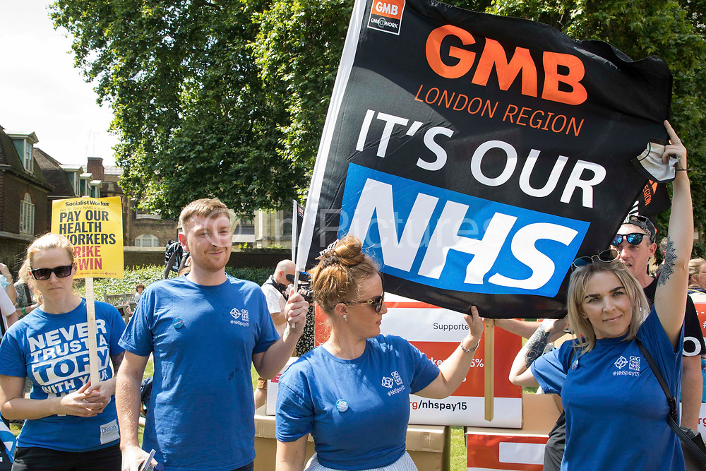 NHS workers from the grassroots NHSPay15 campaign prepare to march from opposite Parliament to 10 Downing Street with a petition started by NHS Wales nurse Matthew Tovey c and signed by over 800,000 people calling for a 15% pay rise for NHS workers on 20th July 2021 in London, United Kingdom. At the time of presentation of the petition, the government was believed to be preparing to offer NHS workers a 3% pay rise in recognition of the unique impact of the pandemic on the NHS.