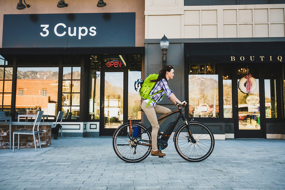 Amanda Cordell cruises through downtown Holladay on a spring afternoon, Utah.