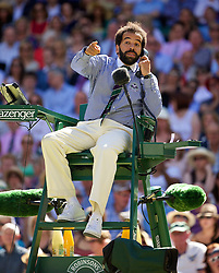 03.07.2014, All England Lawn Tennis Club, London, ENG, WTA Tour, Wimbledon, Tag 10, im Bild Chair umpire Kader Nouni halts the game in the first set tie-break to call for medical assistant for a spectator who was taken ill during the Ladies' Singles Semi-Final match on day ten // during day 10 of the Wimbledon Championships at the All England Lawn Tennis Club in London, Great Britain on 2014/07/03. EXPA Pictures © 2014, PhotoCredit: EXPA/ Propagandaphoto/ David Rawcliffe<br /> <br /> *****ATTENTION - OUT of ENG, GBR*****