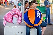 Oct. 21, 2009 -- PHOENIX, AZ: A boy with a prize on the midway at the Arizona State Fair in Phoenix, AZ. The fair runs through November 8.   Photo by Jack Kurtz