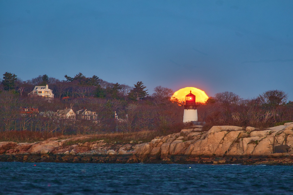 Cold Full moon setting behind Ten Pound Island Lighthouse in Gloucester Massachusetts on Cape Ann.<br /> <br /> Picturesque Massachusetts full Cold Moon setting behind Ten Pound Island Lighthouse photography images are available as museum quality photography prints, canvas prints, acrylic prints, wood prints or metal prints. Fine art prints may be framed and matted to the individual liking and decorating needs:<br /> <br /> https://juergen-roth.pixels.com/featured/cold-full-moon-and-ten-pound-island-lighthouse-juergen-roth.html<br /> <br /> Good light and happy photo making!<br /> <br /> My best,<br /> <br /> Juergen