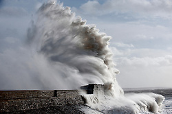 © London News Pictures. 08/02/2014. Porthcawl, UK. Waves crash against Porthcawl Lighthouse along the seafront on the West Coast of wales on February 08,2014. The West coast of the UK is braced for intense storm weather over the next 24 hours. Photo credit : Graham M. Lawrence/LNP.