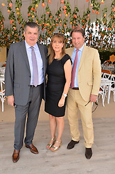 Left to right, JEAN MARC LACAVE Veuve Clicquot President & CEO, his wife CAROL LACAVE and JO THONTON MD of Moet Hennessy UK at the Veuve Clicquot Gold Cup Final at Cowdray Park Polo Club, Midhurst, West Sussex on 20th July 2014.