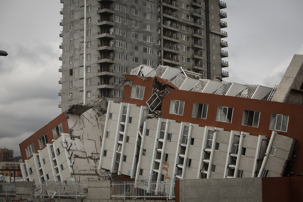 A tower block toppled by the earthquake lies on its side in Concepción. Natural disasters cause significant psychological and social suffering. Many people were severely traumatised by the earthquake and tsunami in Chile.