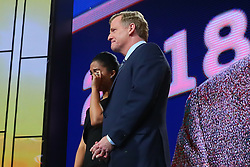 April 26, 2018 - Arlington, TX, U.S. - ARLINGTON, TX - APRIL 26: Ryan Shazier's  Fiancee Michelle Rodriguez wipes away tears as she stands with NFL Commissioner Roger Goodell during the first round at the 2018 NFL Draft at AT&T Statium on April 26, 2018 at AT&T Stadium in Arlington Texas.  (Photo by Rich Graessle/Icon Sportswire) (Credit Image: © Rich Graessle/Icon SMI via ZUMA Press)