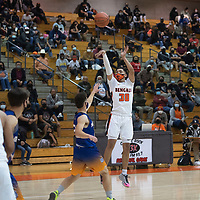 Gallup Bengal Joaquin Ortega (30) shoots a three-pointer against the Bloomfield Bobcats Tuesday evening at Gallup High School in Gallup.