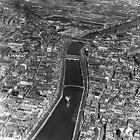 A175 Dublin City Centre. 10/08/51   (Part of the Independent Newspapers Ireland/NLI collection.)<br /> <br /> <br /> These aerial views of Ireland from the Morgan Collection were taken during the mid-1950's, comprising medium and low altitude black-and-white birds-eye views of places and events, many of which were commissioned by clients. From 1951 to 1958 a different aerial picture was published each Friday in the Irish Independent in a series called, 'Views from the Air'.<br /> The photographer was Alexander 'Monkey' Campbell Morgan (1919-1958). Born in London and part of the Royal Artillery Air Corps, on leaving the army he started Aerophotos in Ireland. He was killed when, on business, his plane crashed flying from Shannon.