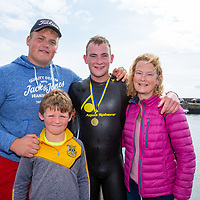 Swimmer Cormac Browne with his family Cathal, Maria and Charlie, from Clooney at the Annual Pat Conway and friends Charity Swim from Lahinch to Liscannor Pier in aid of the Burren Chernobyl Project