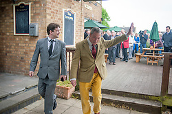 © Licensed to London News Pictures. 29/04/2014. Slough, UK. Nigel Farage leave The Lynchpin pub after meeting with supporters there.  NIGEL FARAGE leader of UKIP in Slough today 29 April 2014 to congratulate local activists on more than doubling the candidates the party will field in local elections. Photo credit : Stephen Simpson/LNP