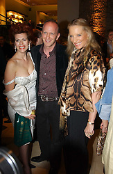 Left to right, CLEO ROCCOS, SIMON SEBAG-MONTEFIORE and HRH PRINCESS MICHAEL OF KENT at a party to celebrate the publication of 'Last Voyage of The Valentina' by Santa Montefiore at Asprey, 169 New Bond Street, London W1 on 12th April 2005.<br />