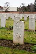 The headstone of a Jewish soldier. Faubourg DAmiens cemetery is the burial site of 2678 identified casualties and a memorial to thousands more from the First and Second World War.  It is looked after and managed by the Commonwealth War Graves Commission in the town of Arras, France.