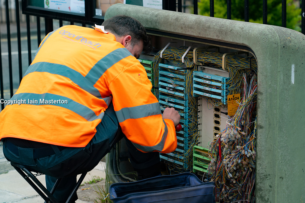 Engineer from BT Openreach working with wiring  at junction box on street