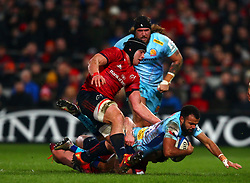 Tom O'Flaherty of Exeter Chiefs is tackled by Andrew Conway of Munster Rugby - Mandatory by-line: Ken Sutton/JMP - 19/01/2019 - RUGBY - Thomond Park - Limerick,  - Munster Rugby v Exeter Chiefs -
