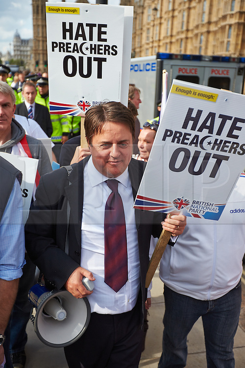 © Licensed to London News Pictures.  01/06/2013. LONDON, UK. BNP leader Nick Griffin (pictured centre) at a rally of supporters outside the Houses of Parliament. Police were forced to separate rival protests by the BNP and anti-fascist groups in Whitehall. The BNP initially wanted to march in Woolwich, scene of the murder of a solider recently, but were banned by police from doing so.  Photo credit: Cliff Hide/LNP