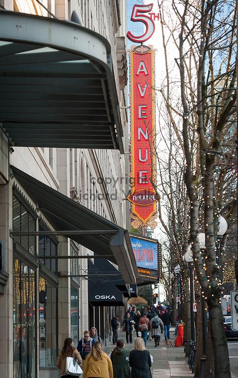 2017 DECEMBER 12 - People walk along 5th Ave near 5th Avenue Theatre, downtown Seattle, WA, USA. By Richard Walker
