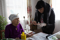 Nina Morozova, 84, has her blood sugar levels measured by MSF nurse Ksinia Tsvierkornova as part of the home visits programme run by MSF in the town of Debaltsevo , which since the conflict has been cut off from Ukraine.