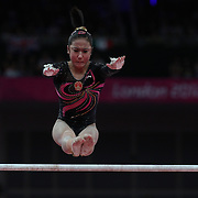 Qiushuang Huang, China,, in action on the Uneven Bars during the Women's Individual All-Around competition at North Greenwich Arena, during the London 2012 Olympic games. London, UK. 2nd August 2012. Photo Tim Clayton