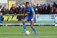 AFC Wimbledon defender Paul Kalambayi (30) dribbling during the EFL Sky Bet League 1 match between AFC Wimbledon and Doncaster Rovers at the Cherry Red Records Stadium, Kingston, England on 9 March 2019.