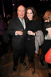 JULIAN FELLOWES and FELICITY BLUNT at the annual Orion Publishing Group's Author party held in the Paul Hamlyn Hall, The Royal Opera House, Covent Garden, London on 22nd February 2010.