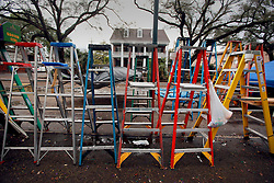 17 Feb 2015. New Orleans, Louisiana.<br /> Early morning Mardi Gras Day. Lines of ladders awaiting revelers on St Charles Avenue before the big parades start to roll.<br /> Photo; Charlie Varley/varleypix.com