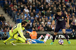 BARCELONA, April 30, 2017  Barcelona's Luis Suarez(R) shoots as Espanyol's goalie Diego Lopez(L) defends during the Spanish first division (La Liga) soccer match between RCD Espanyol and FC Barcelona at RCDE Stadium in Barcelona, Spain, April 29, 2017. Barcelona won 3-0. (Credit Image: © Lino De Vallier/Xinhua via ZUMA Wire)