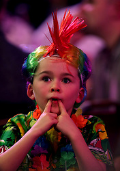 A young fan reacts whilst watching the action during day twelve of the William Hill World Darts Championships at Alexandra Palace, London.