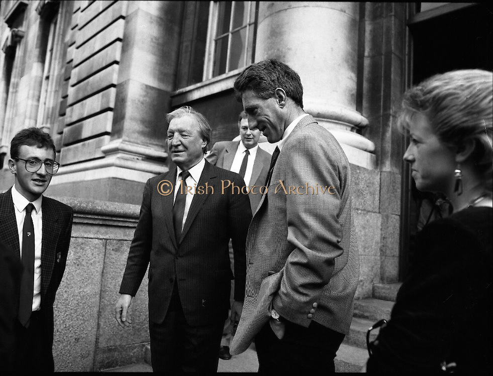 Sean Kelly Welcomed At Government Buildings. (R79).1988..19.05.1988..05.19.1988..19th May 1988..After his win in the Vuelta a España (Tour of Spain) cycle race, Sean Kelly was welcomed back to Dublin by An Taoiseach, Charles Haughey TD. He was greeted and congratulated at Government Buildings, Leinster House, Dublin...Image shows (from left) Martin Earley (who also competed in the Vuelta),An Taoiseach, Charles Haughey TD, Sean Kelly and Linda Kelly on the steps of Government Buildings.