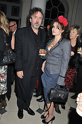 TIM BURTON and HELENA BONHAM-CARTER at a private view of Story Teller by photographer Tim Walker supported by Mulberry held at Somerset House, The Strand, London on 17th October 2012.