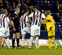 Photo: Leigh Quinnell.<br /> West Bromwich Albion v Burnley. Coca Cola Championship. 18/11/2006. Burnleys Frank Sinclair is upset with referee R.Beeby after being sent off.