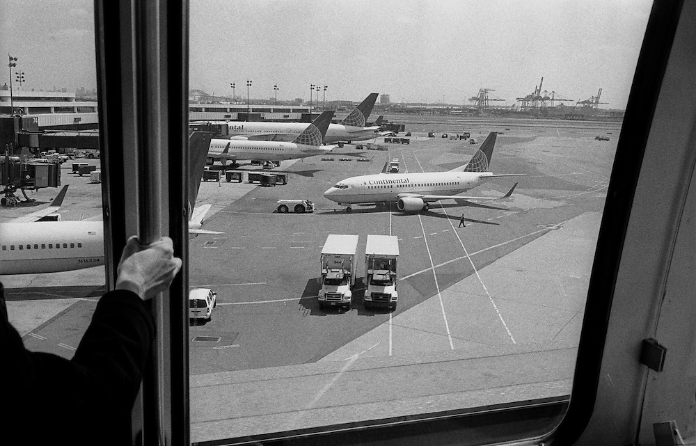 """Scene from the AirTrain at Newark International Airport. Continental Airlines, 737...Part of long-term (2005-2008) story """"I See A Darkness"""". New York, NY."""