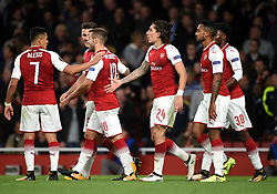 Arsenal's Hector Bellerin (centre) celebrates scoring his side's third goal of the game with team mates